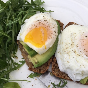 Poached eggs on rye with rocket